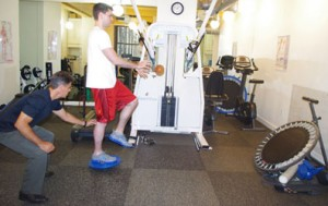 A patient does exercises to strengthen muscles following ACL reconstruction surgery.
