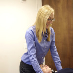 A patient receives manual and verbal cues from her physical therapist.